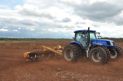 Tractor that levels the ground to host new plants.